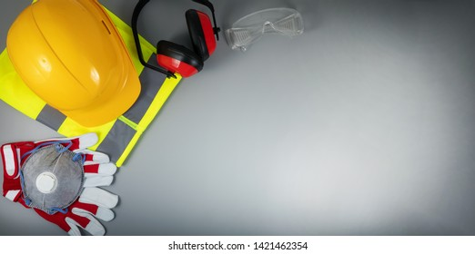 occupational safety and health - work safety items of construction industry on gray background with copy space