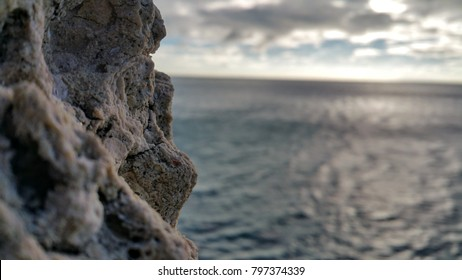 Ocean background with rock wall in focus