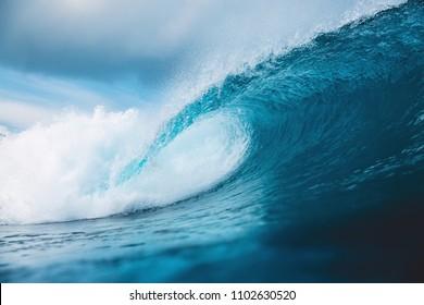 Ocean barrel wave in ocean. Breaking wave for surfing in Bali