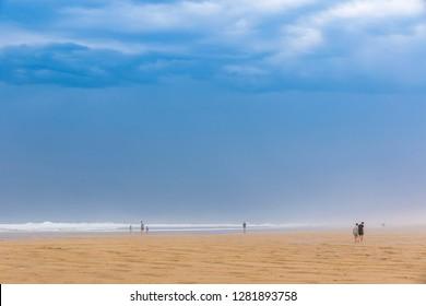 Ocean beach on the Atlantic coast of France near Lacanau-Ocean, Bordeaux, France. Windy and cloudy summer day