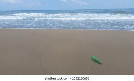 Ocean, beach and a plastic bottle