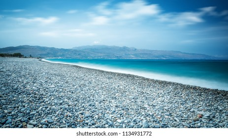 Ocean beach with turquoise water on the Crete long explosure