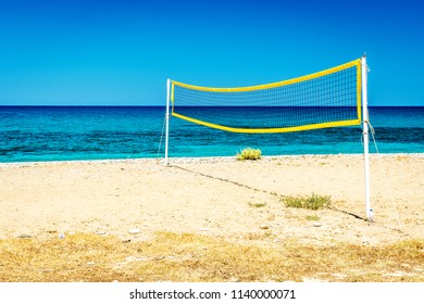 Ocean beach with volleyball net  on the Crete in sunny day