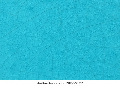 Ocean blue crack ceramic tile. Sea color of glazed tile texture abstract background. Texture of turquoise crackle glass mosaic tile.