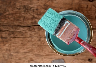ocean blue paint  brush on color can on old rustic  wood background,DIY handmade concept