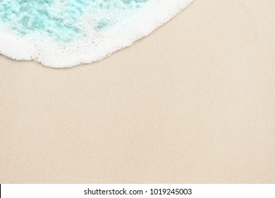 Ocean blue wave on the sand background