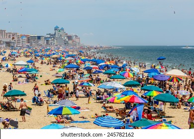 OCEAN CITY - JULY 6: Crowded beach in Ocean City, MD on July 6, 2014. Ocean City, MD is a popular beach resorts on East Coast and one of the cleanest in the country.