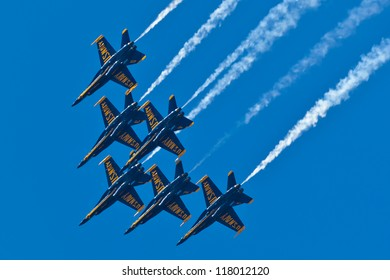 OCEAN CITY - JUNE 9:US Navy Blue Angels performing demo routine flying special painted f-18 Hornets on June 9, 2012 in Ocean City, Maryland. Blue Angels are the oldest demonstration team in the world