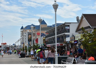 OCEAN CITY, MARYLAND - JUL 1: The famous Boardwalk in Ocean City, Maryland, seen on July 1, 2017. The city features miles of beach and a wooden boardwalk lined with restaurants, shops and hotels.