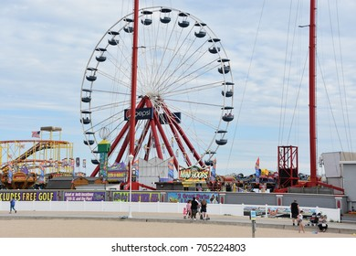 OCEAN CITY, MARYLAND - JUL 1: Jolly Roger Amusement Park in Ocean City, Maryland, on July 1, 2017. The city It features miles of beach and a wooden boardwalk lined with restaurants, shops and hotels.