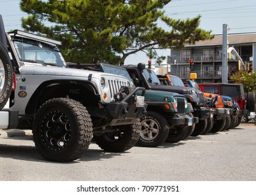 OCEAN CITY, MD - AUGUST 26, 2017: Closeup on a row of Jeep front ends parked side by side, extending into to the background. at Jeep Week 2017 in Ocean City, Maryland.