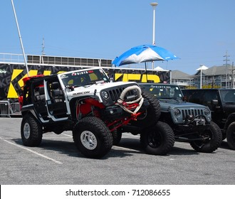 OCEAN CITY, MD - AUGUST 26, 2017: One Jeep Rubicon demonstrates a typical Jeep stunt on another Rubicon, at Jeep Week in Ocean City, Maryland.