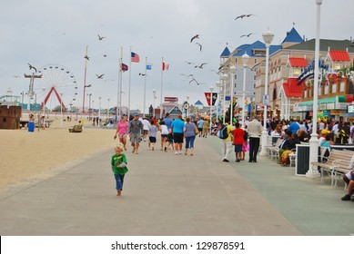 OCEAN CITY, MD - JUNE 04: People at Ocean City Boardwalk on June 04, 2010 in Ocean City , MD USA. People walking ,and having fun at the famous Ocean City Beach boardwalk with many attractions.