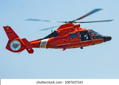 Ocean City, MD / USA - June 18, 2017: U.S. Coast Guard SAR demo during OC Airshow on June 18, 2017 in Ocean City, MD. Search and rescue (SAR) is one of the Coast Guard's oldest missions.