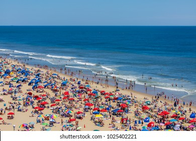 Ocean City, MD / USA - June 14, 2016: Crowded beach in Ocean City, MD on June 14, 2016. Ocean City, MD is a popular beach resort on the East Coast and one of the cleanest in the country.