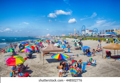 Ocean City, NJ - July, 6, 2016 -vacationers enjoy the sun and sand on Ocean City's boardwalk and beach.