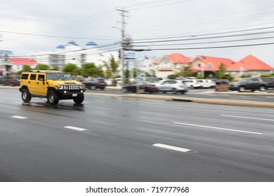OCEAN CITY, USA - MAY 28 2017 : Pan image of yellow hummer , yellow hummer was going around street of ocean city.