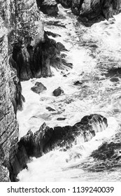 Ocean cliffs on the Cape of Good Hope, South Africa in black and white