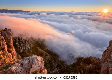 Ocean of a cloud and sky of dawn. Crimea. Gore Ay-Petri. Mountain landscape. Mountain cloudy landscape. Cloudy landscape. Crimean landscape. Clouds are painted by flowers of dawn. Mountain top.