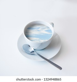 Ocean and clouds in a coffee cup