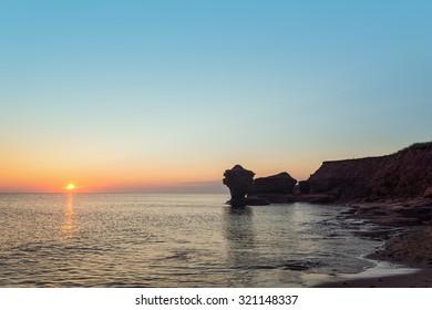 Ocean coast at the sunrise (Central Coastal Drive, Prince Edward Island, Canada)