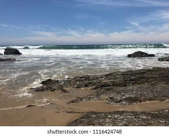 Ocean coastline beach surf and rock