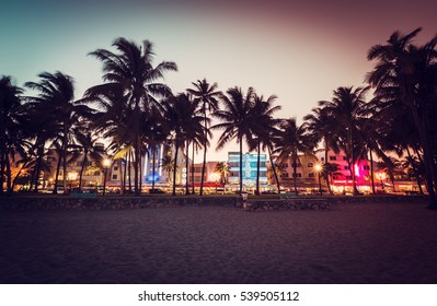 Ocean Drive street with illuminated buildings in Miami , Florida. Vintage desaturated colors