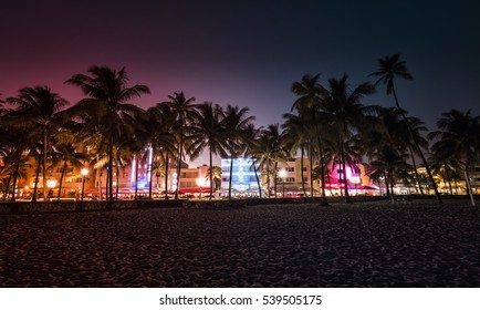 Ocean Drive street with illuminated buildings in Miami , Florida. Vintage colors