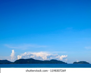 The ocean from the ferry on approach to Koh Chang Island in eastern Thailand. The forested slopes can be seen.