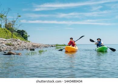 ocean kayaking near an island on a sunny day