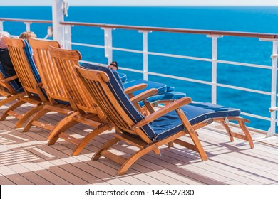 Ocean Liner Cruising. Wooden Deck Chairs and Some Tourist on Route to Destination.
