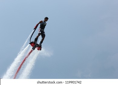 OCEAN MARINA, PATTAYA, THAILAND-NOV. 24: Unidentfied man demonstrates flyboard acrobatics, November 24, 2012 at the boat show in Ocean Marina, Pattaya, Thailand.