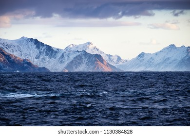 Ocean and mountain ridge at the morning time. Beautiful natural seascape in the Norway