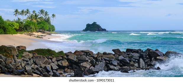 Ocean, picturesque beach and blue sky. Coastline of Sri Lanka. Wide photo.
