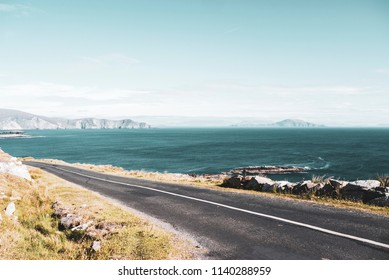 Ocean road with the Minaun Cliffs in the background. Taken on a sunny summer day on Achill Island along the Wild Atlantic Way.
