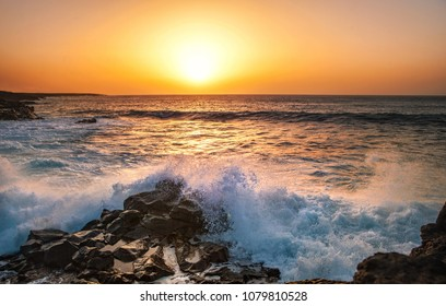 Ocean and rock at the sunset. Nature composition.