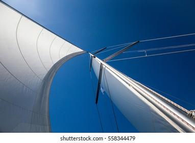 Ocean sails on a blue sky