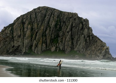 Ocean scene with lone surfer.
