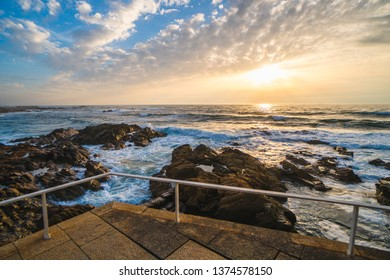 Ocean scenery, powerful waves at colorful sunset in Portugal