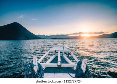 Ocean sea sunset seen from a white boat