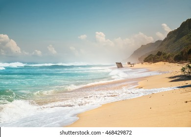 Ocean shore line with waves on a beach. Island beach paradise with sea waves. Tropical sea beach of Bali island, Indonesia. Tropical island beach, outdoor sea landscape photography, travel concept