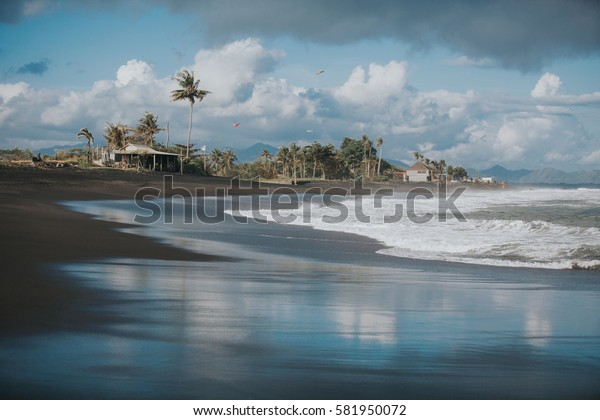 Ocean shore line with waves on a beach. Bali, Indonesia.