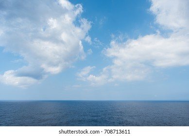 Ocean and sky. Nature background of sea horizon and clouds