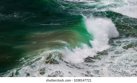 Ocean storm with with big windy waves. Background shot of clear sea water surface