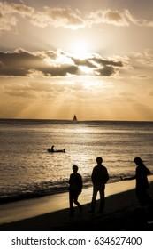 Ocean Sunset with People Silhouettes on Beach