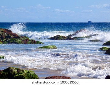 Ocean Surf crashing on rocks