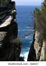 Ocean view between cliffs