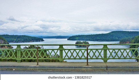 Ocean View Bridge on Deception Pass State Park Oak Harbor Washington State railing islands sky trees water are visible