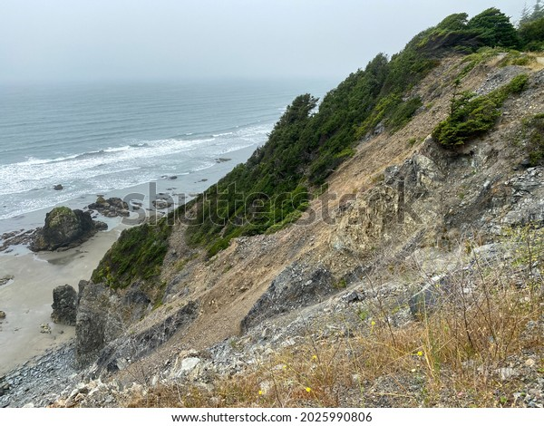 a ocean view hiking trail mountain cliff hazy foggy mist overlook