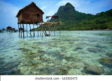 Ocean view of a sea gypsy village house on Mabul Island in Celebes Sea, Sabah, Malaysia.